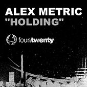 Holding by Alex Metric